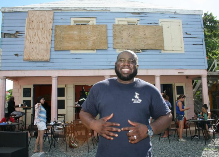 Restaurant owner Omar Hurst found he owned waterfront property after three shops blew away in front of his eatery
