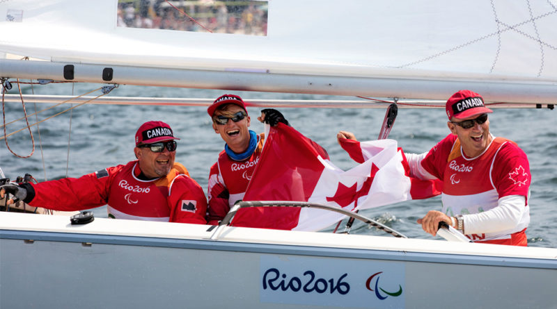 sharing-medal-winning-smiles-are-the-Sonar-team-of-Paul-Tingley-Scott-Lutes-and-Logan-Campbell-who-raced-in-Brazil-Olympics-in-2016.-Credit-World-Sailing-Richard-Langdon